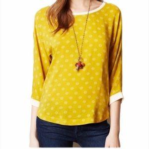 Anthropologie Maeve yellow polka dot blouse.